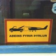 This picture was taken in Iceland. The sign says, for helicopters only, and according to the sign airplanes will be towed away presumably at owners expense.