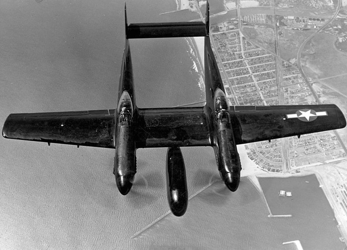 P-82 in black night fighter motif. Note the large bulge that carries the radar array under the wing